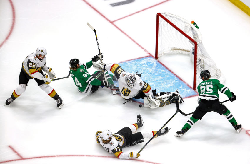 Joel Kiviranta #25 of the Dallas Stars attempts a shot on Robin Lehner #90 of the Vegas Golden Knights as Nick Holden #22 checks Roope Hintz #24 into the goal during the second period in Game Three of the Western Conference Final. (Photo by Bruce Bennett/Getty Images)
