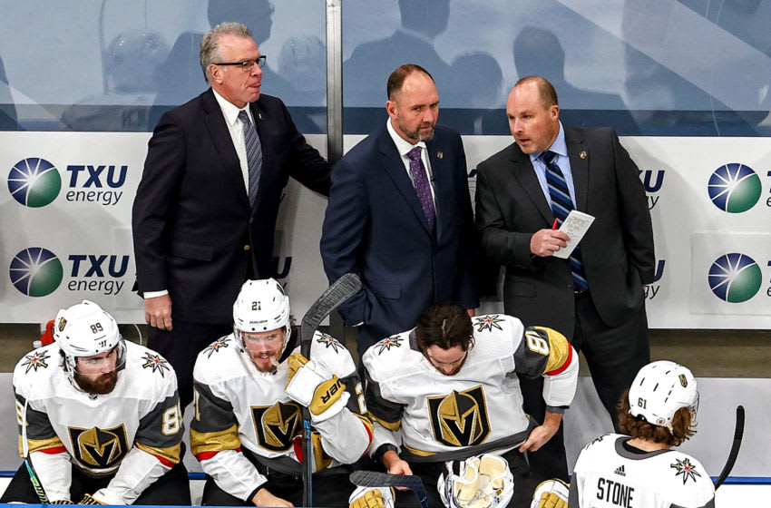 Head coach Peter DeBoer of the Vegas Golden Knights speaks with his staff during the first period against the Dallas Stars in Game Four of the Western Conference Final. (Photo by Bruce Bennett/Getty Images)