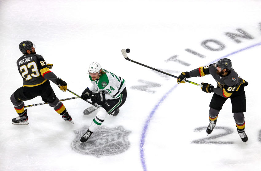 Alex Tuch #89 of the Vegas Golden Knights handles the puck against Roope Hintz #24 of the Dallas Stars as Alec Martinez #23 looks on during the first period in Game Five of the Western Conference Final. (Photo by Bruce Bennett/Getty Images)