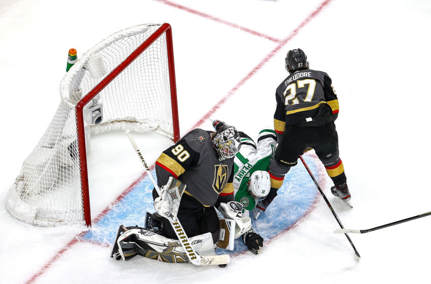 Robin Lehner #90 of the Vegas Golden Knights covers up the puck against Corey Perry #10 of the Dallas Stars during the third period in Game Five of the Western Conference Final. (Photo by Bruce Bennett/Getty Images)