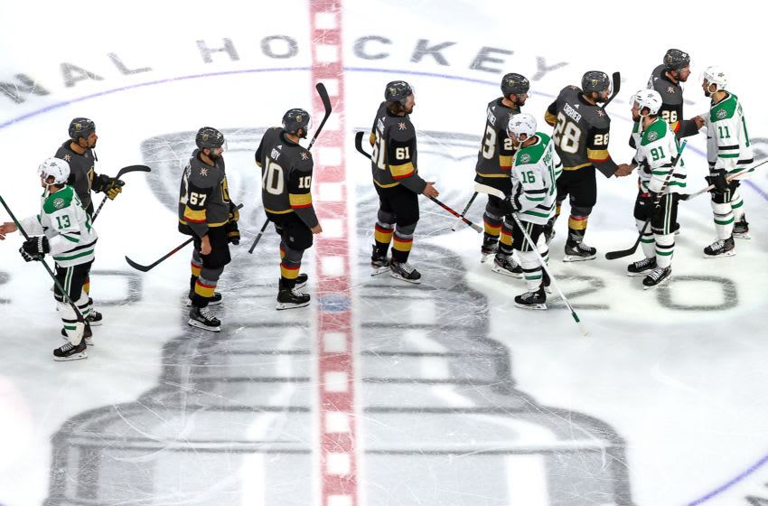The Vegas Golden Knights and the Dallas Stars shake hands following the Stars 3-2 overtime victory in Game Five of the Western Conference Final. (Photo by Bruce Bennett/Getty Images)