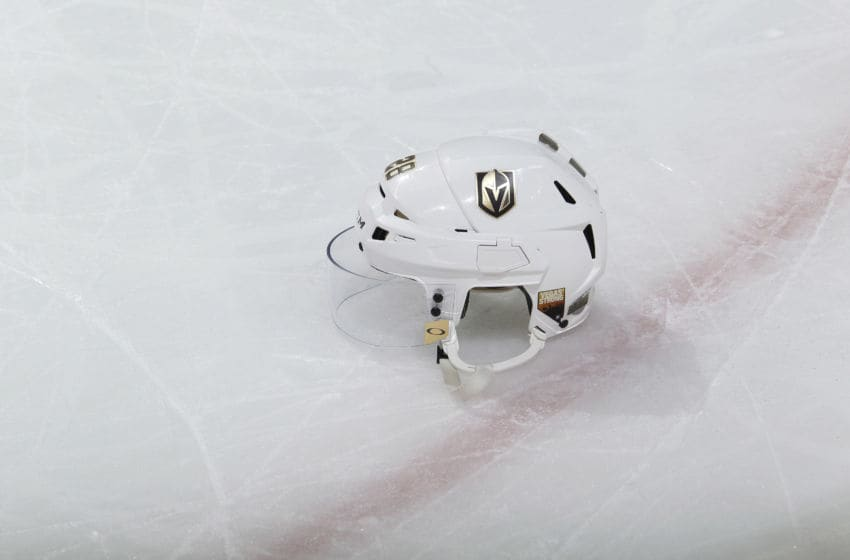 The helmet belonging to William Carrier #28 of the Vegas Golden Knights sits on the ice. (Photo by Rocky W. Widner/NHL/Getty Images)