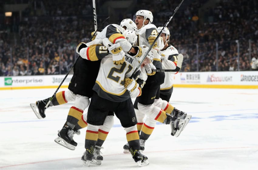 LOS ANGELES, CA - APRIL 15: Cody Eakin #21 is congratulated by Jon Merrill #15, Ryan Carpenter #40 and Colin Miller #6 of the Vegas Golden Knights during the third period in Game Three of the Western Conference First Round against the Los Angeles Kings during the 2018 NHL Stanley Cup Playoffs at Staples Center on April 15, 2018 in Los Angeles, California. (Photo by Sean M. Haffey/Getty Images)