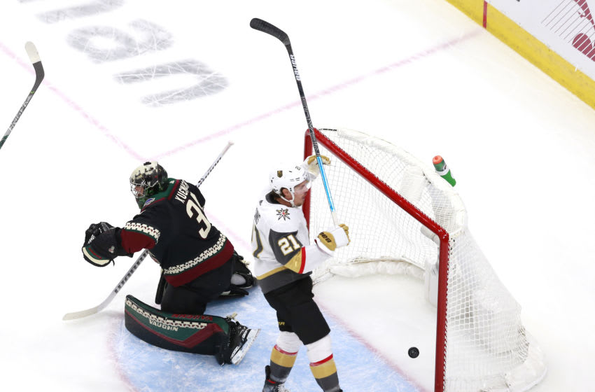 Darcy Kuemper #35 of the Arizona Coyotes is unable to stop a power play goal by Reilly Smith of the Vegas Golden Knights as Nick Cousins #21 of the Vegas Golden Knights celebrates. (Photo by Jeff Vinnick/Getty Images)