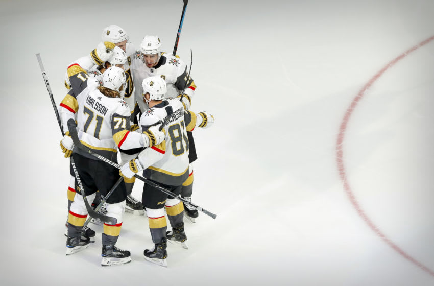Vegas Golden Knights defenseman Shea Theodore (27) and right wing Mark Stone (61) and center William Karlsson (71) and center Jonathan Marchessault (81) celebrates a goal scored by Theodore. Mandatory Credit: Perry Nelson-USA TODAY Sports