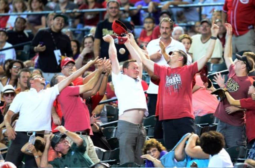Aug 9, 2015; Phoenix, AZ, USA; Fans go after a ball during the game between the Arizona Diamondbacks and the Cincinnati Reds at Chase Field. The Diamondbacks won 4-3 in ten innings. Mandatory Credit: Joe Camporeale-USA TODAY Sports