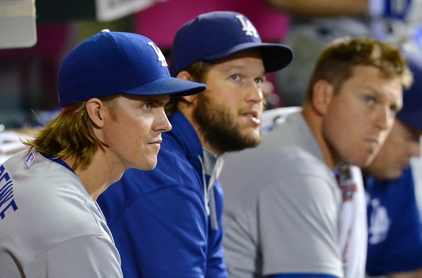 Sep 7, 2015; Anaheim, CA, USA; Los Angeles Dodgers starting pitcher Zack Greinke (21) and starting pitcher Clayton Kershaw (22) and catcher A.J. Ellis (17) in the dugout during the seventh of the game against the Los Angeles Angels at Angel Stadium of Anaheim. Mandatory Credit: Jayne Kamin-Oncea-USA TODAY Sports