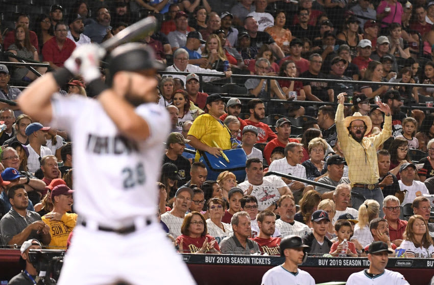 PHOENIX, AZ - SEPTEMBER 06: A fan cheers as Steven Souza Jr. #28 of the Arizona Diamondbacks stands at bat in the fourth inning of the MLB game against the Atlanta Braves at Chase Field on September 6, 2018 in Phoenix, Arizona. (Photo by Jennifer Stewart/Getty Images)