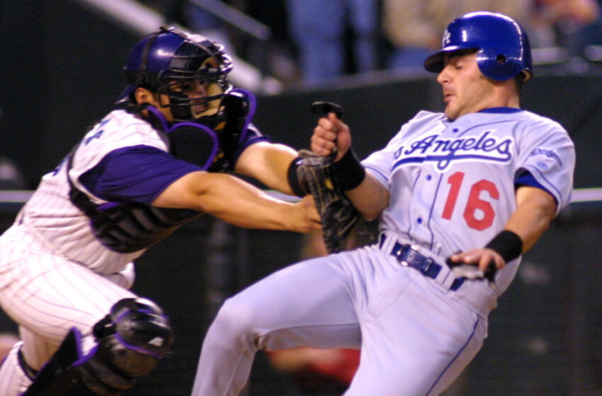 Los Angeles Dodgers' Paul LoDuca (R) is tagged out at home by Arizona Diamondbacks' catcher Rod Barajas during the second inning 12 April 2001 in Phoenix, AZ. LoDuca tried to score from first on a Alex Cora hit. AFP Photo/Mike FIALA (Photo by Mike FIALA / AFP) (Photo by MIKE FIALA/AFP via Getty Images)