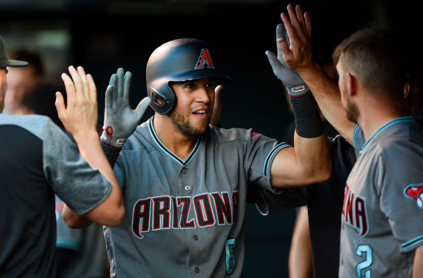 DENVER, CO - JUNE 8: David Peralta #6 of the Arizona Diamondbacks celebrates in the dugout after hitting a third inning homerun against the Colorado Rockies at Coors Field on June 8, 2018 in Denver, Colorado. (Photo by Dustin Bradford/Getty Images)