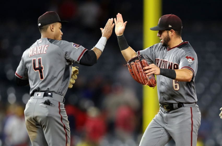ANAHEIM, CA - JUNE 18: Ketel Marte #4 of the Arizona Diamondbacks congratulates David Peralta #6 of the Arizona Diamondbacks after defeating the Los Angeles Angels of Anaheim 7-4 in a game at Angel Stadium on June 18, 2018 in Anaheim, California. (Photo by Sean M. Haffey/Getty Images)