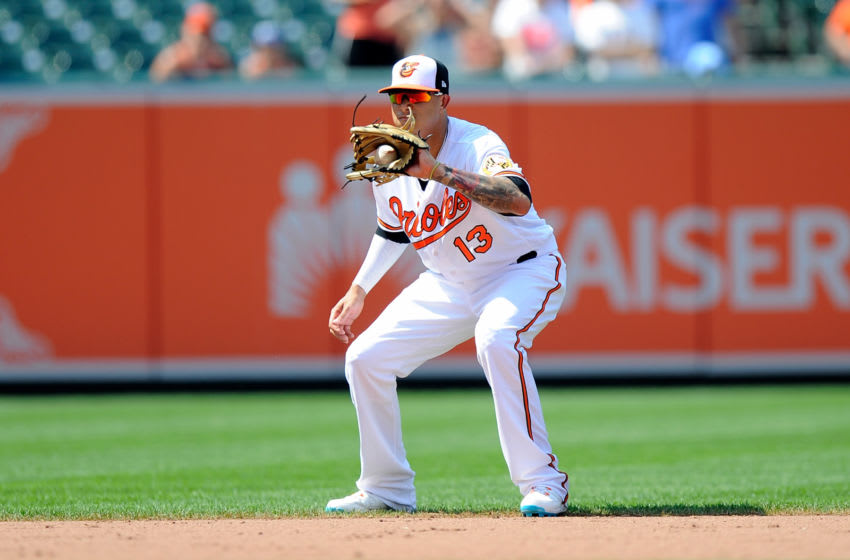 BALTIMORE, MD - JULY 01: Manny Machado #13 of the Baltimore Orioles catches a ball hit by Ian Kinsler #3 (not pictured) of the Los Angeles Angels to end the game in the ninth inning at Oriole Park at Camden Yards on July 1, 2018 in Baltimore, Maryland. (Photo by Greg Fiume/Getty Images)