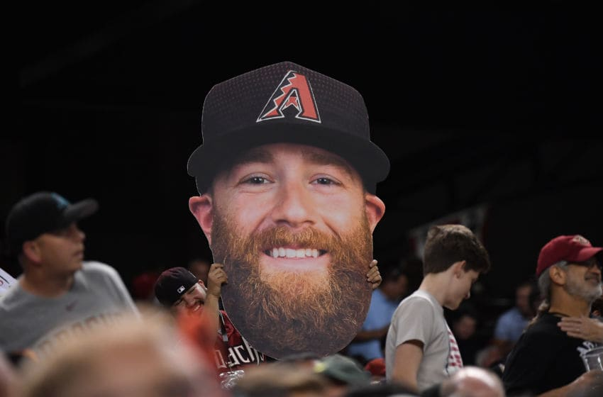 PHOENIX, AZ - OCTOBER 09: A fan holds a poster of Arizona Diamondbacks pitcher Archie Bradley during the National League Divisional Series game three against the Los Angeles Dodgers at Chase Field on October 9, 2017 in Phoenix, Arizona. (Photo by Norm Hall/Getty Images)