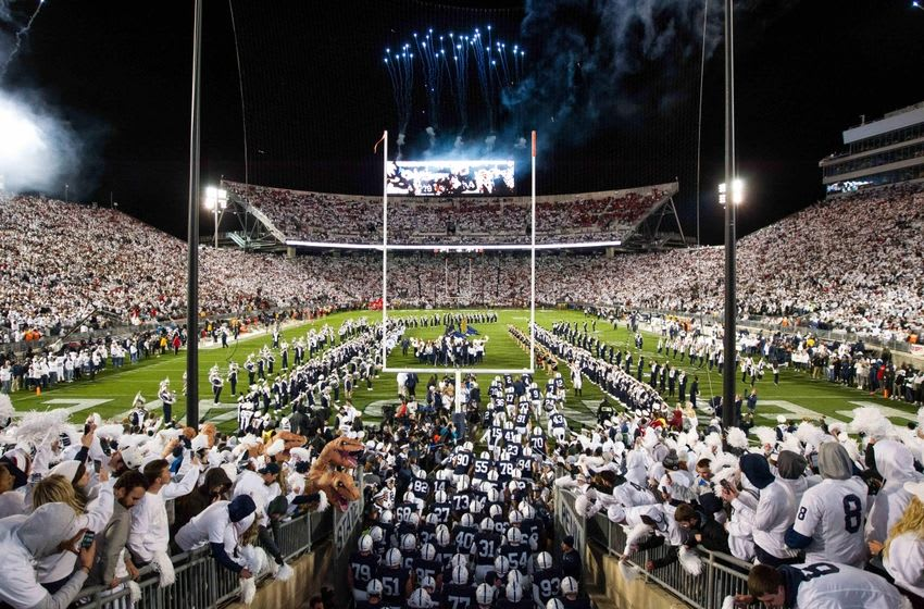 Oct 22, 2016; University Park, PA, USA; Penn State Football players run onto the field prior to the game against the Ohio State Buckeyes at Beaver Stadium. Mandatory Credit: Matthew O