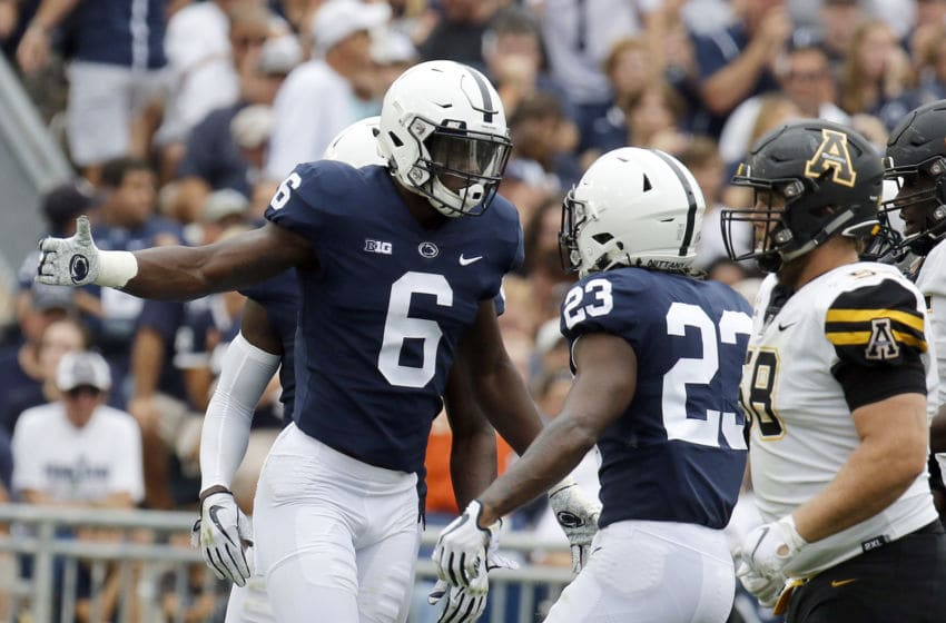 STATE COLLEGE, PA - SEPTEMBER 01: Cam Brown #6 of the Penn State Nittany Lions celebrates his sack with Ayron Monroe #23 of the Penn State Nittany Lions on September 1, 2018 at Beaver Stadium in State College, Pennsylvania. (Photo by Justin K. Aller/Getty Images)