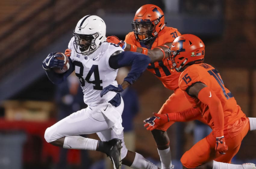 CHAMPAIGN, IL - SEPTEMBER 21: Juwan Johnson #84 of the Penn State Nittany Lions runs the ball after a catch as Cameron Watkins #31 of the Illinois Fighting Illini reaches for the tackle at Memorial Stadium on September 21, 2018 in Champaign, Illinois. (Photo by Michael Hickey/Getty Images)