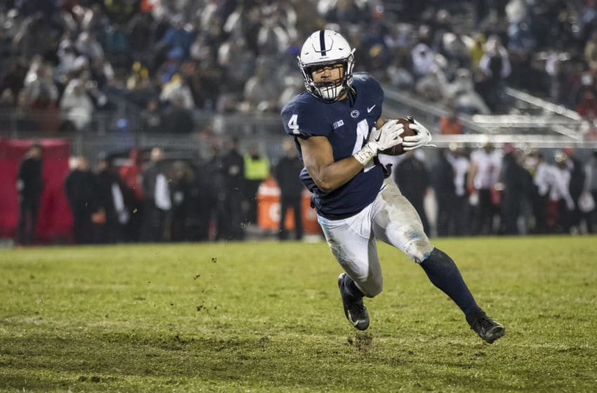 STATE COLLEGE, PA - NOVEMBER 24: Ricky Slade #4 of the Penn State Nittany Lions scores a touchdown against the Maryland Terrapins during the second half at Beaver Stadium on November 24, 2018 in State College, Pennsylvania. (Photo by Scott Taetsch/Getty Images)