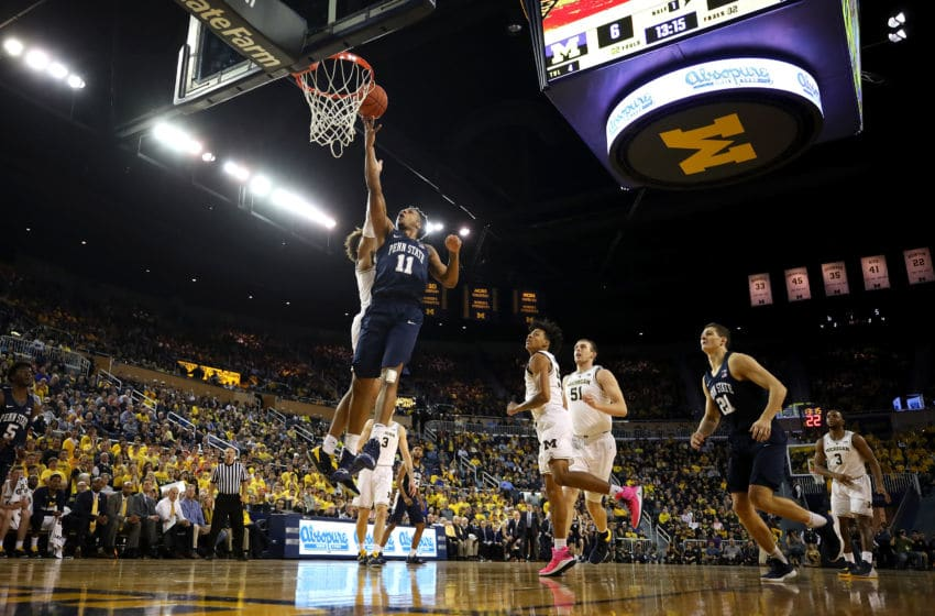 ANN ARBOR, MICHIGAN - JANUARY 03: Lamar Stevens #11 of the Penn State Nittany Lions drives to the basket past Jordan Poole #2 of the Michigan Wolverines during the first half at Crisler Arena on January 03, 2019 in Ann Arbor, Michigan. Michigan won the game 68-55. (Photo by Gregory Shamus/Getty Images)