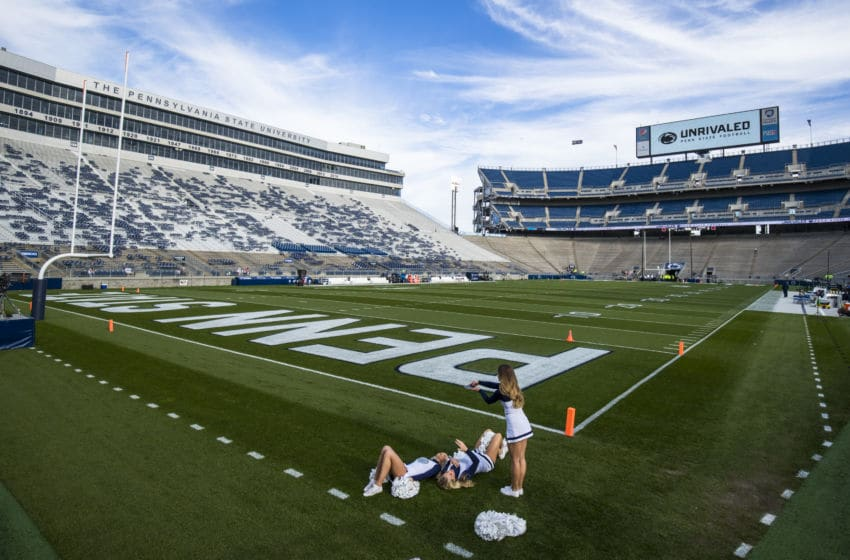 UNIVERSITY PARK, PA - OCTOBER 19: General view as Penn State Nittany Lions cheerleaders photograph each other on the field before the game against the Michigan Wolverines on October 19, 2019 at Beaver Stadium in University Park, Pennsylvania. (Photo by Brett Carlsen/Getty Images)