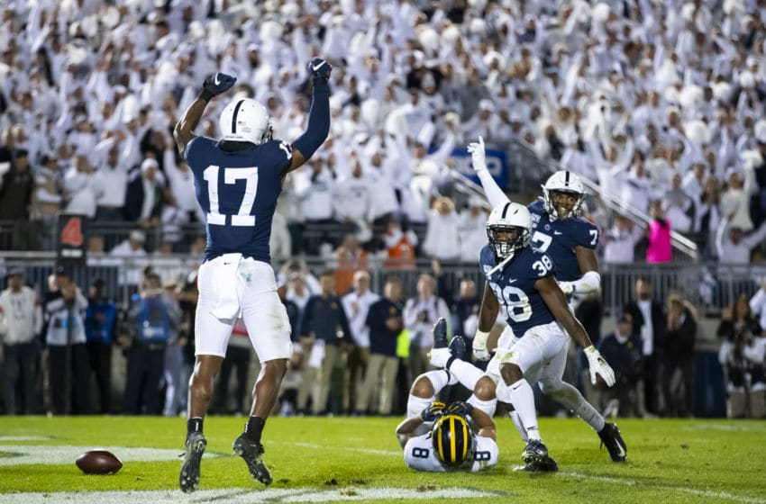 UNIVERSITY PARK, PA - OCTOBER 19: Garrett Taylor #17, Lamont Wade #38 and Jaquan Brisker #7 of the Penn State Nittany Lions celebrate a fourth down stop in the final minutes of the game against the Michigan Wolverines on October 19, 2019 at Beaver Stadium in University Park, Pennsylvania. Penn State defeats Michigan 28-21. (Photo by Brett Carlsen/Getty Images)