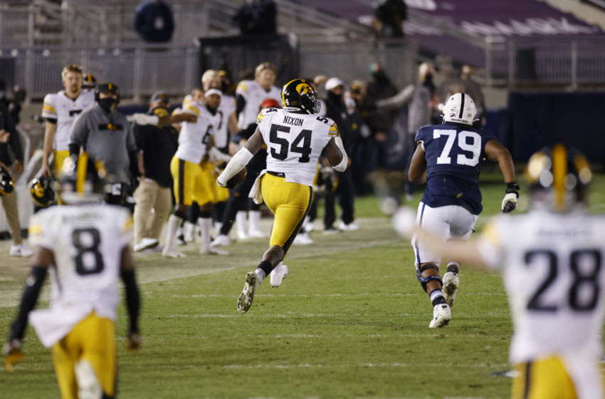 STATE COLLEGE, PA - NOVEMBER 21: Daviyon Nixon #54 of the Iowa Hawkeyes returns an interception for a touchdown against the Penn State Nittany Lions in the fourth quarter of the game at Beaver Stadium on November 21, 2020 in State College, Pennsylvania. Iowa won 41-21. (Photo by Joe Robbins/Getty Images)