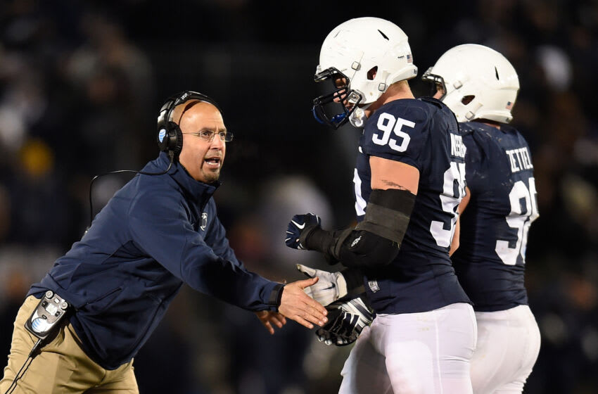 Head coach James Franklin congratulates Carl Nassib #95 of the Penn State Nittany Lions after a third down stop against the Michigan State Spartans at Beaver Stadium on November 29, 2014 in State College, Pennsylvania. (Photo by Joe Sargent/Getty Images)