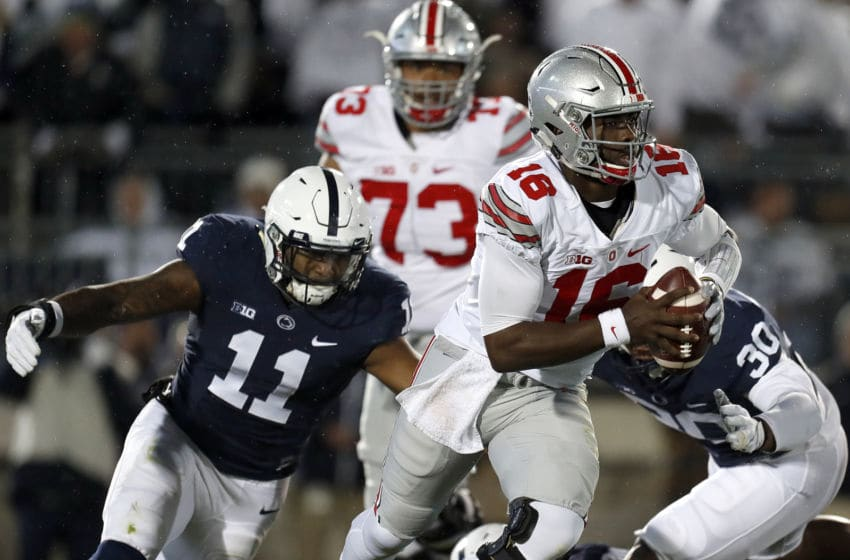 STATE COLLEGE, PA - OCTOBER 22: J.T. Barrett #16 of the Ohio State Buckeyes is hurried by Brandon Bell #11 of the Penn State Nittany Lions in the first half during the game on October 22, 2016 at Beaver Stadium in State College, Pennsylvania. (Photo by Justin K. Aller/Getty Images)