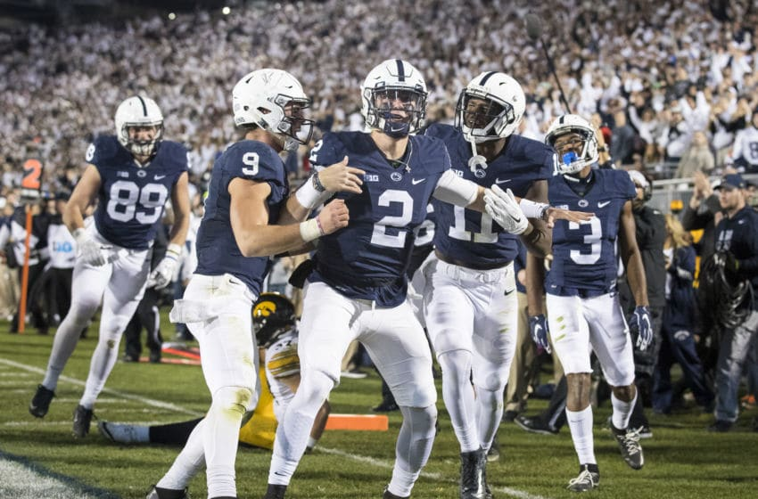 STATE COLLEGE, PA - NOVEMBER 05: Tommy Stevens #2 of the Penn State Nittany Lions is congratulated after his touchdown run by Trace McSorley #9 and Irvin Charles #11 during the second half against the Iowa Hawkeyes on November 5, 2016 at Beaver Stadium in State College, Pennsylvania. Penn State defeats Iowa 41-14. (Photo by Brett Carlsen/Getty Images)