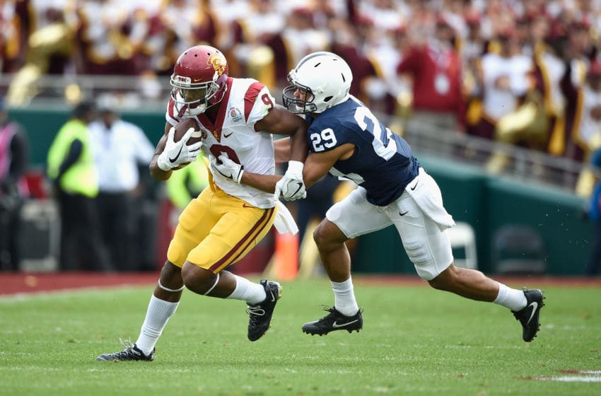PASADENA, CA - JANUARY 02: Cornerback John Reid #29 of the Penn State Nittany Lions attempts to tackle wide receiver JuJu Smith-Schuster #9 of the USC Trojans during the 2017 Rose Bowl Game presented by Northwestern Mutual at the Rose Bowl on January 2, 2017 in Pasadena, California. (Photo by Kevork Djansezian/Getty Images)