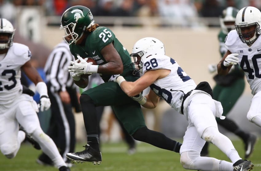 EAST LANSING, MI - NOVEMBER 04: Darrell Stewart Jr. #25 of the Michigan State Spartans is tackled by Troy Apke #28 of the Penn State Nittany Lions after a first half catch at Spartan Stadium on November 4, 2017 in East Lansing, Michigan. (Photo by Gregory Shamus/Getty Images)