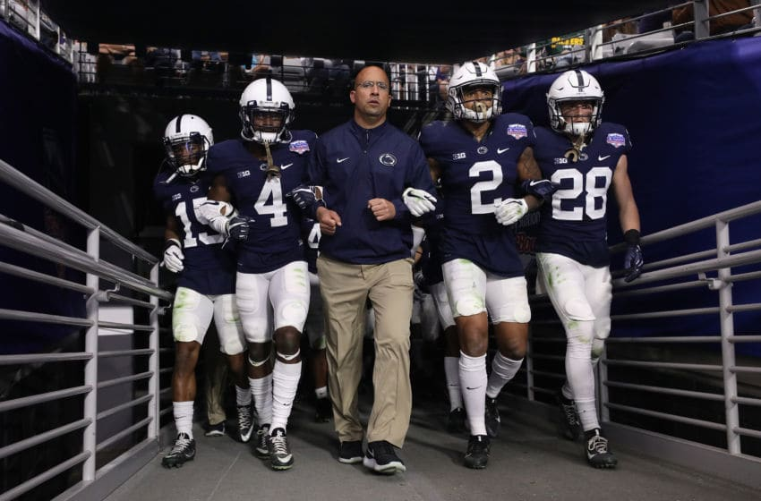 GLENDALE, AZ - DECEMBER 30: (L-R) Grant Haley #15, Nick Scott #4, head coach James Franklin, Marcus Allen #2 and Troy Apke #28 of the Penn State Nittany Lions walk out to field arm in arm before the start of the second half of the Playstation Fiesta Bowl against the Washington Huskies at University of Phoenix Stadium on December 30, 2017 in Glendale, Arizona. The Nittany Lions defeated the Huskies 35-28. (Photo by Christian Petersen/Getty Images)