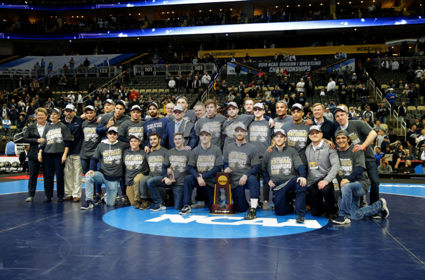 PITTSBURGH, PA - MARCH 23: Members and staff of the Penn State Nittany Lion wrestling team pose for a team photo after winning the team title of the NCAA Wrestling Championships on March 23, 2019 at PPG Paints Arena in Pittsburgh, Pennsylvania. (Photo by Hunter Martin/NCAA Photos via Getty Images)