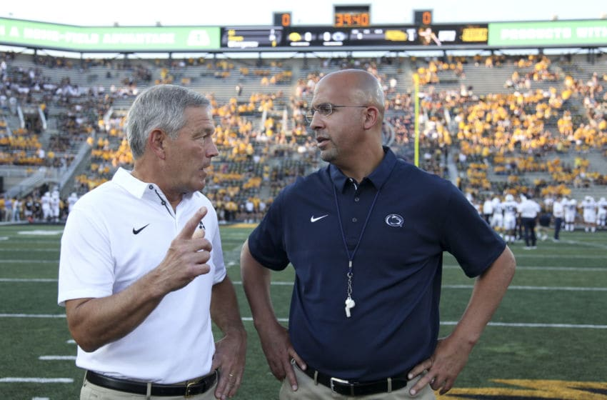 IOWA CITY, IOWA- SEPTEMBER 23: Head coach James Franklin of the Penn State Nittany Lions visits with head coach Kirk Ferentz of the Iowa Hawkeyes before their match-up on September 23, 2017 at Kinnick Stadium in Iowa City, Iowa. (Photo by Matthew Holst/Getty Images)