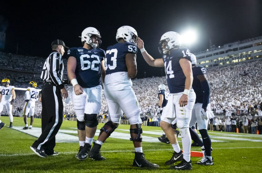 UNIVERSITY PARK, PA - OCTOBER 19: Sean Clifford #14 of the Penn State Nittany Lions celebrates a touchdown run during the second quarter against the Michigan Wolverines on October 19, 2019 at Beaver Stadium in University Park, Pennsylvania. (Photo by Brett Carlsen/Getty Images)