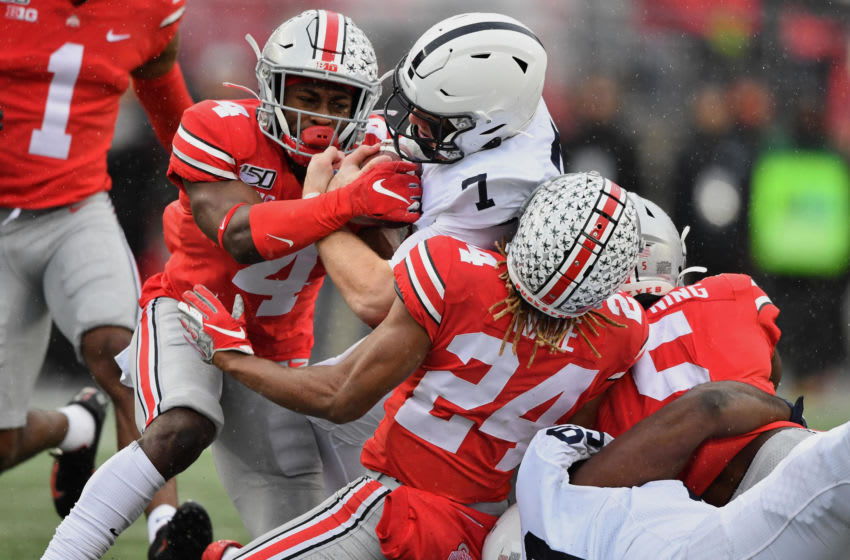 COLUMBUS, OH - NOVEMBER 23: Quarterback Will Levis #7 of the Penn State Nittany Lions is dragged down by Jordan Fuller #4, Shaun Wade #24, and Baron Browning #5, all of the Ohio State Buckeyes, in the third quarter after a gain for a first down at Ohio Stadium on November 23, 2019 in Columbus, Ohio. Ohio State defeated Penn State 28-17. (Photo by Jamie Sabau/Getty Images)
