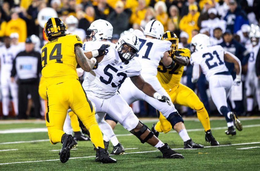 Iowa defensive end A.J. Epenesa (94) gets blocked by Penn State offensive lineman Rasheed Walker (Image via HawkCentral)