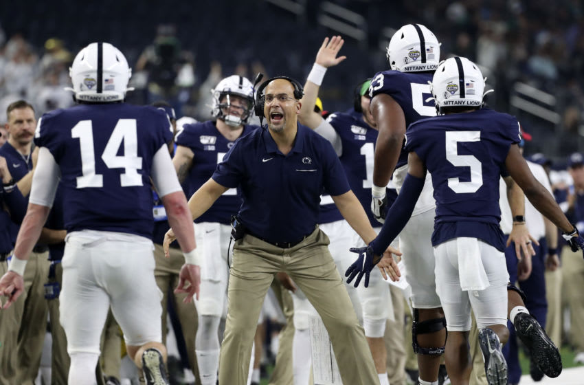 Dec 28, 2019; Arlington, Texas, USA; Penn State Nittany Lions head coach James Franklin celebrates with wide receiver Jahan Dotson (5) and quarterback Sean Clifford (14) after a touchdown during the second quarter against the Memphis Tigers at AT&T Stadium. Mandatory Credit: Kevin Jairaj-USA TODAY Sports