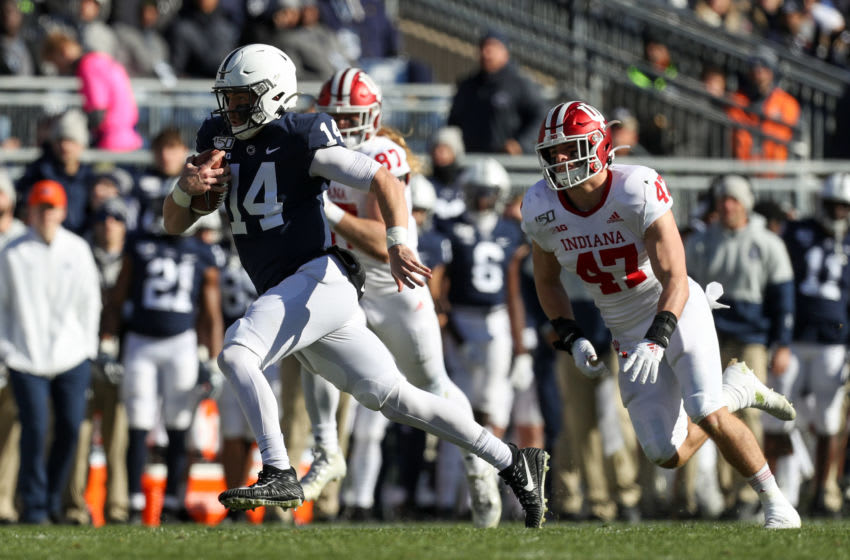 Nov 16, 2019; University Park, PA, USA; Penn State Nittany Lions quarterback Sean Clifford (14) runs with the ball while Indiana Hoosiers linebacker Micah McFadden (47) pursues during the first quarter at Beaver Stadium. Mandatory Credit: Matthew O'Haren-USA TODAY Sports