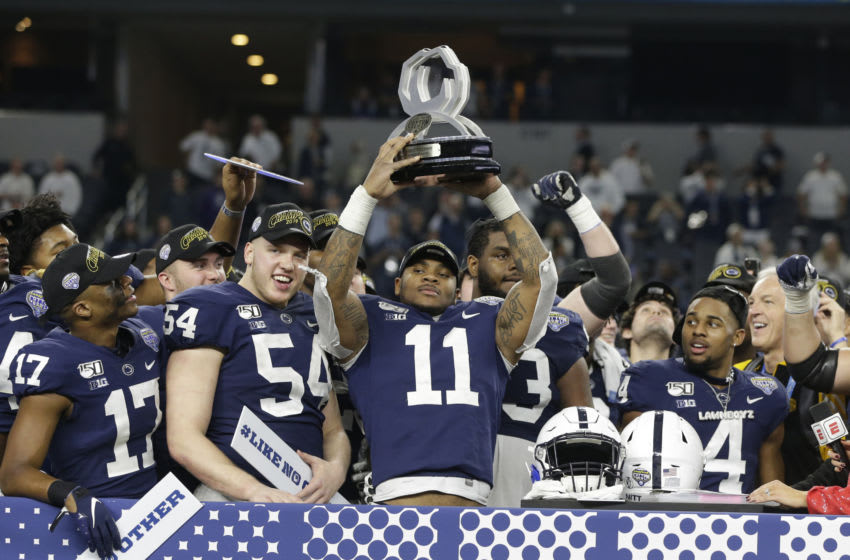 Dec 28, 2019; Arlington, Texas, USA; Penn State Nittany Lions linebacker Micah Parsons (11) holds up the most outstanding defensive player award after the game against the Memphis Tigers at AT&T Stadium. Mandatory Credit: Tim Heitman-USA TODAY Sports