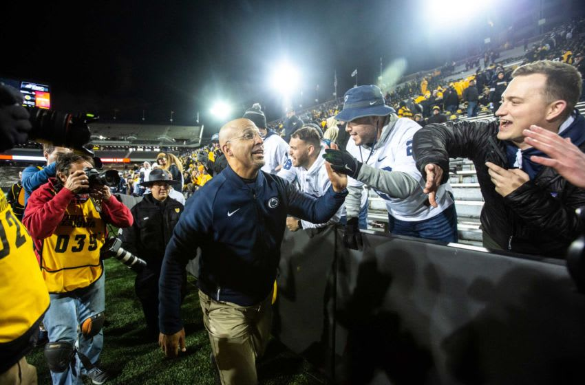 Penn State head coach James Franklin high-fives fans after a NCAA Big Ten Conference football game between the Iowa Hawkeyes and Penn State, Saturday, Oct., 12, 2019, at Kinnick Stadium in Iowa City, Iowa. 191012 Penn St Iowa Fb 077 Jpg
