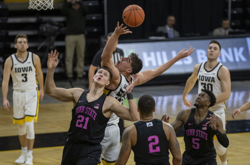 Sunday, Feb. 21, 2021; Iowa City, Iowa, USA; Iowa center Luka Garza (55) reaches for a rebound during the second half of a men's basketball game against Penn State on Sunday, Feb. 21, 2021 at Carver Hawkeye Arena. The Hawkeyes defeated the Nittany Lions, 74-68. Garza broke the record for Iowa's all-time leading scorer and now has a career total of 2,126 points. Mandatory Credit: Hannah Kinson/Daily Iowan via USA TODAY Network
