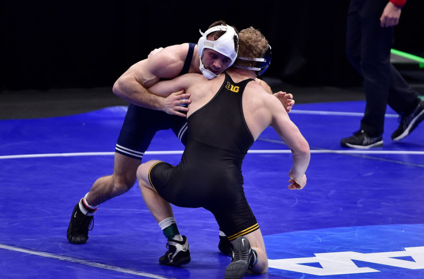 Mar 18, 2021; St. Louis, Missouri, USA; Pen State Nittany Lions wrestler Brady Berge wrestles Iowa Hawkeyes wrestler Kaleb Young during the NCAA Division I Wrestling Championships at Enterprise Center. Mandatory Credit: Jeff Curry-USA TODAY Sports
