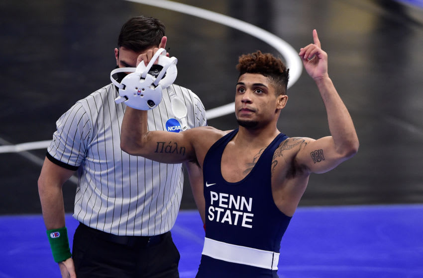 Mar 19, 2021; St. Louis, Missouri, USA; Penn State Nittany Lions wrestler Roman Bravo Young celebrates after defeating Virginia Tech Hokies wrestler Korbin Myers in the 133 weight class during the semifinals of the NCAA Division I Wrestling Championships at Enterprise Center. Mandatory Credit: Jeff Curry-USA TODAY Sports