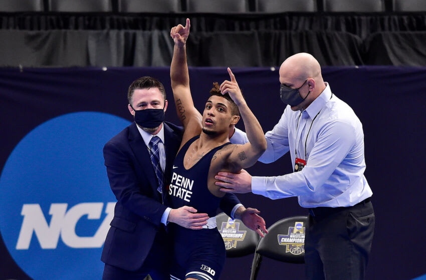 Mar 20, 2021; St. Louis, Missouri, USA; Penn State Nittany Lions wrestler Roman Bravo-Young celebrates after defeating Oklahoma State Cowboys wrestler Daton Fix in the championship match of the 133 weight class during the finals of the NCAA Division I Wrestling Championships at Enterprise Center. Mandatory Credit: Jeff Curry-USA TODAY Sports