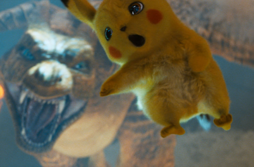 (L-R) Charizard and Detective Pikachu (RYAN REYNOLDS) in Legendary Pictures' and Warner Bros. Pictures' comedy adventure