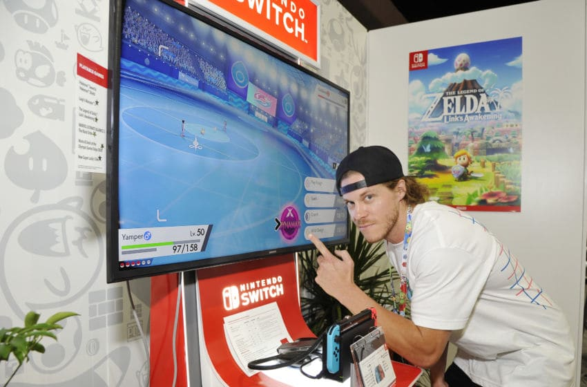 LOS ANGELES, CALIFORNIA - JUNE 12: Blake Anderson checks out 'Pokémon Sword and Pokémon Shield' for the Nintendo Switch system during the 2019 E3 Gaming Convention at Los Angeles Convention Center on June 12, 2019 in Los Angeles, California. (Photo by John Sciulli/Getty Images for Nintendo)