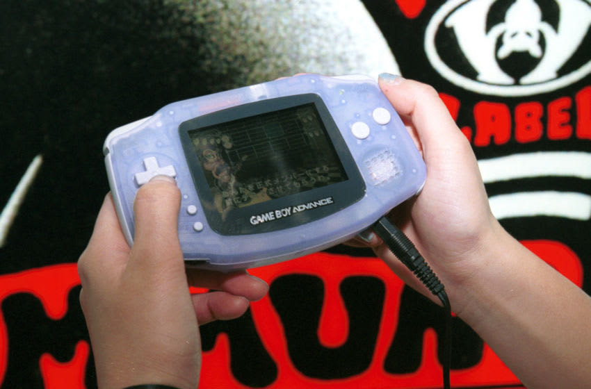 387339 03: A Nintendo promotion representative shows off the company's next-generation hand-held console Game Boy Advance at the Tokyo Game Show April 1, 2001 in Tokyo, Japan. The faster Game Boy Advance, which uses a 32-bit processor and is Internet-enabled, hit the shops in Japan for 9,800 yen (80 USD) March 21 to rave reviews. (Photo by Koichi Kamoshida/Newsmakers)