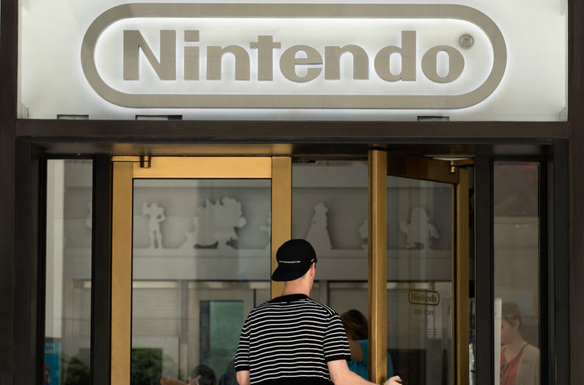 NEW YORK, NY - JULY 11: A man enters Nintendo's flagship store, July 11, 2016 in New York City. The success of Nintendo's new smartphone game, Pokemon Go, has sent shares of Nintendo soaring. (Photo by Drew Angerer/Getty Images)