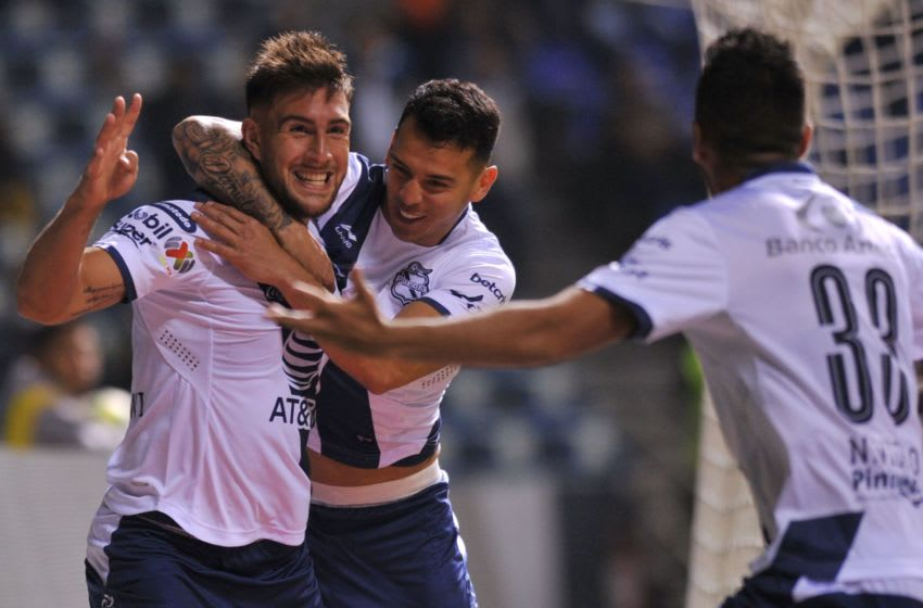 Lucas Cavallini (L) of Puebla celebrates his goal against Pumas with teammates during the Mexican Clausura 2019 tournament football match against Puebla at Cuauhtemoc stadium in Puebla, Puebla state, on March 15, 2019. (Photo by ROCIO VAZQUEZ / AFP) (Photo credit should read ROCIO VAZQUEZ/AFP/Getty Images)