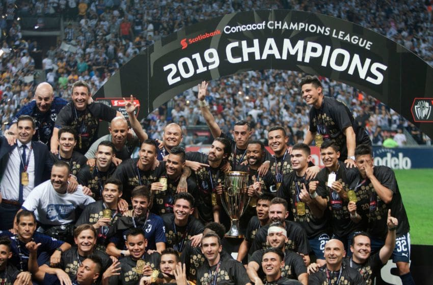 Monterrey players celebrate with the Concacaf Champions League trophy after beating the Tigres to win the 2019 title. The Rayados did not qualify for the 2020 tournament so there will be a new CCL champ. (Photo by Julio Cesar AGUILAR / AFP) (Photo credit should read JULIO CESAR AGUILAR/AFP via Getty Images)